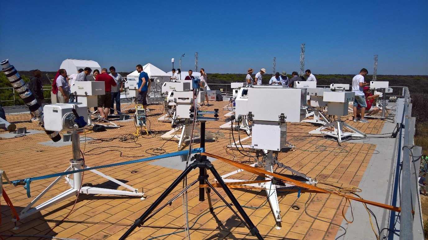 Solar UV intercomparison at the 12th RBCC-E campaign held from 17-27 June 2019 at El Arenosillo, INTA, Spain. The QASUME reference spectroradiometer is seen in the front with the Brewer spectroradiometers in the background